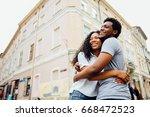 happy african american couple... | Shutterstock . vector #668472523
