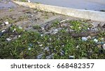 waste and water hyacinth in the ...   Shutterstock . vector #668482357