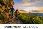 mountain biking women and man... | Shutterstock . vector #668570017