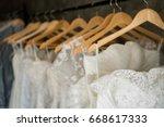 beautiful wedding dresses on a... | Shutterstock . vector #668617333