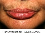 female lips with a mustache on... | Shutterstock . vector #668626903