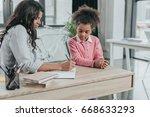 mother helping little daughter... | Shutterstock . vector #668633293