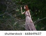 woman in a dress in the woods   ...   Shutterstock . vector #668649637