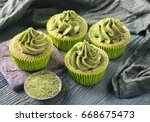 matcha cup cakes on a wooden... | Shutterstock . vector #668675473