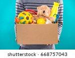 male volunteer holding donation ... | Shutterstock . vector #668757043