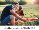 young dog owner enjoying in the ... | Shutterstock . vector #668787193