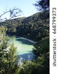 Small photo of Hiking through the Abel Tasman National Park, New Zealand