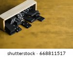 box full of dominoes | Shutterstock . vector #668811517