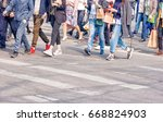 many people crossing the... | Shutterstock . vector #668824903