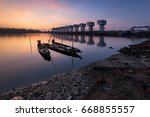 a beautiful morning floodgates  ... | Shutterstock . vector #668855557