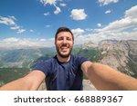 hiker at the top of a pass... | Shutterstock . vector #668889367