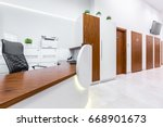 reception desk in long hallway... | Shutterstock . vector #668901673