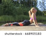 a sporty woman doing yoga and... | Shutterstock . vector #668905183