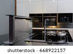 stove and cooking hood on... | Shutterstock . vector #668922157