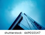 commercial buildings at night... | Shutterstock . vector #669010147