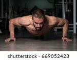 athlete doing push up as part... | Shutterstock . vector #669052423