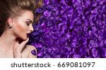 the girl in the petals.... | Shutterstock . vector #669081097