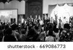 blurred image of people raising ... | Shutterstock . vector #669086773