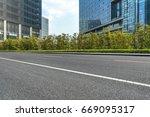 empty asphalt road front of...   Shutterstock . vector #669095317