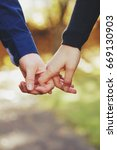 couple hand holding | Shutterstock . vector #669130903