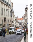 Small photo of LISBON, PORTUGAL, on June 22, 2017. People go on a brisk shopping street to downtown