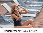 beautiful  slender girl in a... | Shutterstock . vector #669173497