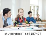 two concentrated groupmates... | Shutterstock . vector #669187477