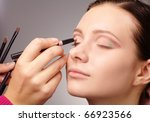 stylist is applying eyeshadow... | Shutterstock . vector #66923566