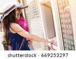 using an atm machine to take... | Shutterstock . vector #669253297