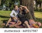 beautiful young couple sitting...   Shutterstock . vector #669317587