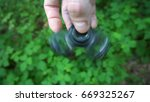 black hand spinner  or... | Shutterstock . vector #669325267