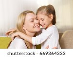 mum and her cute daughter child ...   Shutterstock . vector #669364333