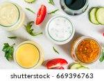 set of dressings for salad ... | Shutterstock . vector #669396763