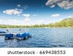 Paddling Boats On A Lake