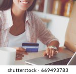 smiling woman online shopping... | Shutterstock . vector #669493783