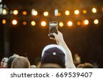 fan recording concert with... | Shutterstock . vector #669539407