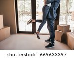 cropped image of happy couple...   Shutterstock . vector #669633397