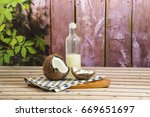 coconut juice and oil  | Shutterstock . vector #669651697