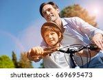 admirable motivated parent... | Shutterstock . vector #669695473