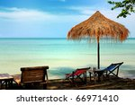 sun chair under umbrella on a... | Shutterstock . vector #66971410