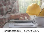 architect engineer using laptop ... | Shutterstock . vector #669759277