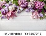 flowers frame on white wooden... | Shutterstock . vector #669807043