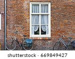 white window with curtain and... | Shutterstock . vector #669849427