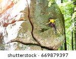 the girl climber climbs the...   Shutterstock . vector #669879397