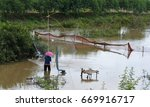 Small photo of Fishermen flatter fish in streams. By the countryside of Thailand