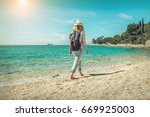blonde woman in summer hat with ... | Shutterstock . vector #669925003