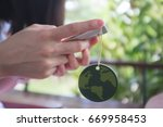 close up woman hand holding or... | Shutterstock . vector #669958453