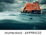 Small photo of life raft floating on the sea