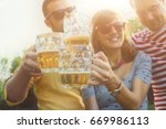 several friends enjoying... | Shutterstock . vector #669986113