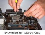 computer motherboard repair... | Shutterstock . vector #669997387
